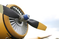 Closeup view of an yellow aircraft propeller