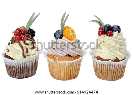 Closeup view of assorted of decorated sweet pastry dessert with berries and fruits against white background #614924474