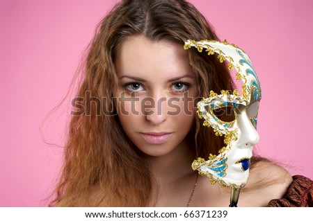 Closeup view of beautiful woman in evening dress with carnival mask
