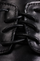 Closeup view of boot with black laces