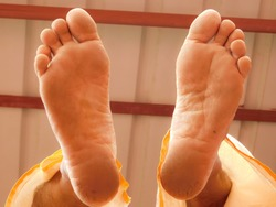 closeup view of bottom side of a mans foot