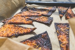 Closeup view of burnt pizza slices