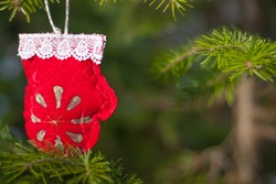Closeup view of christmas decoration. Xmas mockup with red mitten and fir-tree