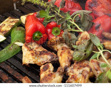Closeup view of delicious barbecue meal with meat and vegetables.