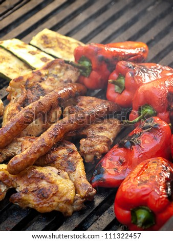 Closeup view of delicious grill with meat and vegetables.