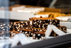 Closeup view of display of panforte chocolate dessert made with fruits and nuts in Siena, Italy in Tuscany