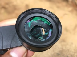 Closeup view of external macro lens of smartphone camera (macro and wide-angle lenses)