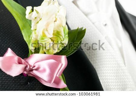 closeup view of flower on groom suit