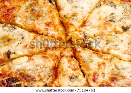 Closeup view of four cheese pizza