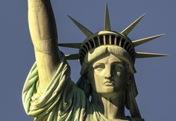 Closeup view of head of Statue of Liberty in Liberty island, New York, in a sunny day.