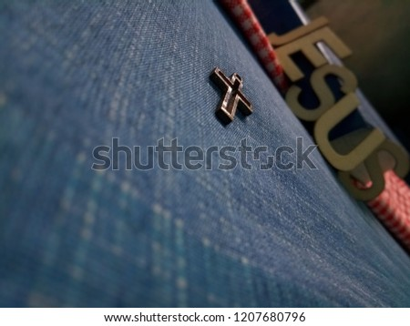 Closeup view of little golden Christian cross with selective focus, Jesus God loving concept picture