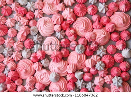 Closeup view of Meringues kisses in various star shapes in pink, light pink  and violet  colors. Homemade meringue cookies. Background . Сток-фото ©