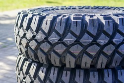 closeup view of new mud and terrain tire tread