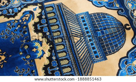 Closeup view of prayer rug in place to make prayer. High angle view of lovely prayer mat or prayer rug for Muslims