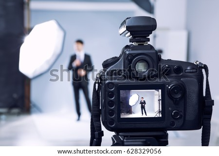 Closeup view of professional camera in studio