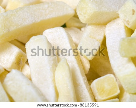 Closeup view of raw and frozen French fries.