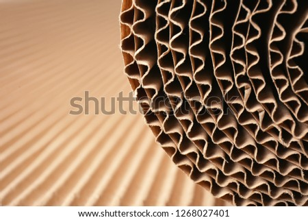 Closeup view of roll of brown corrugated cardboard, space for text. Recyclable material Сток-фото ©