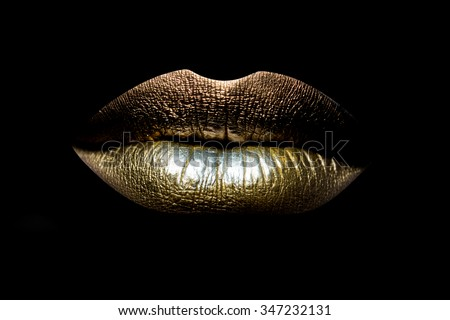 Closeup view of sexual beautiful female closed golden lips isolated on black background, horizontal picture