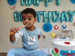 Closeup view of small baby boy celebrates the birthday and Smash cake alone.