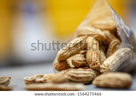 Closeup view of steamed golden groundnuts. Groundnut is scientifically known as Arachis hypogaea.Nuts mix in a plastic bag in table