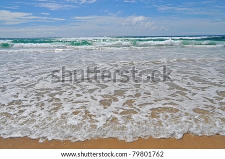 Closeup view of the shoreline. Ocean at Surfers Paradise. Gold Coast, Queensland, Australia