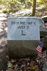 closeup view of the 20th maine infantry marker at little round top at gettysburg