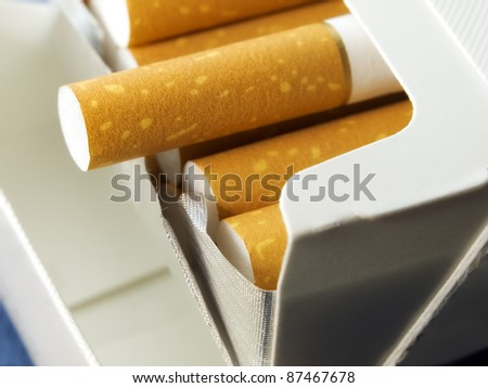 Closeup view on an open pack of cigarettes.