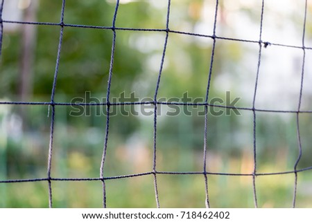 Closeup view on volleyball net. Nice green blurred background. #718462402