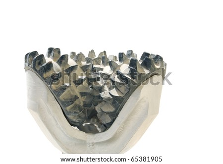 Closeup view Showing the steel tooth arrangement in a tricone rock drilling bit - stock photo