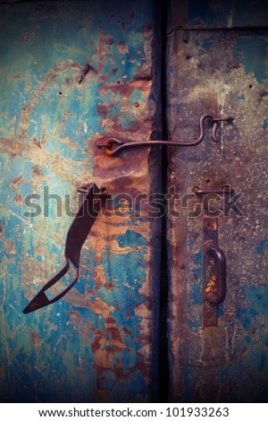 Closeup vintage blue metal door in grungy style.