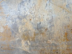 Closeup​ wall​ concrete​ texture​ for​ background. Old wall​ effected​ by​ rust​ for​ background. Cement​ wall​ for​ vintage​ background. Rust​y​ damaged​ to​ surface​ wall.