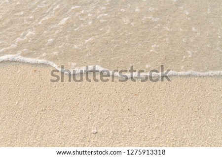 Closeup wave flow on  the beach in southern  of Thailand #1275913318