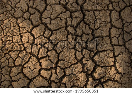 Closeup weathered texture and background of arid cracked ground. Broken dried mud from arid problem. Global warming crisis. Agricultural land without water. Climate change Stock photo ©