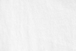 Closeup white crumpled textile texture background. Horizontal picture.