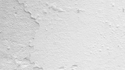 Closeup White grey concrete house distressed wall or ceiling with color paint off and moisture texture background