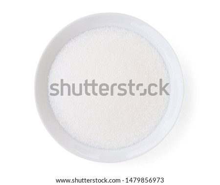 Closeup white sugar in white bowl isolated on white background with clipping path. Unhealthy diet ,awareness and stop diabetes concept. Top view. Flat lay'