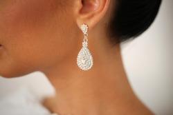 Closeup with bride's elegant crystal ear rings