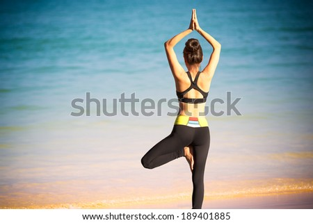 Closeup woman doing exercises on the beach