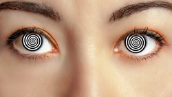 closeup woman face with hypnotized eyes animation