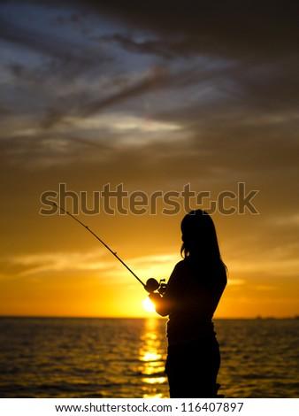 Closeup Woman fishing Mississippi Gulfport Biloxi Sunset
