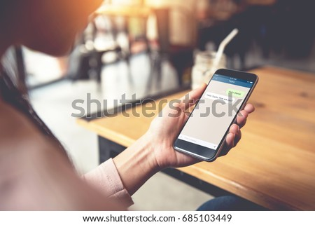 Closeup woman hand holding smart phone, Mock up to screen chat box. Social network, Chating and messaging concept,  #685103449