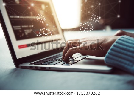 Closeup Woman hand using Laptop pc with email icon, Work from home, Email concept