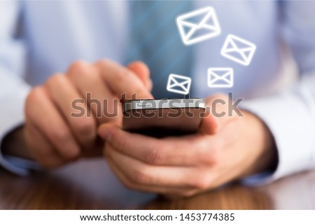 Closeup Woman hand using mobile smartphone with email icon, Email concept, copy space.          - Image