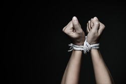 Closeup woman hands were tied with a rope. Violence, Terrified, Human Rights Day concept.