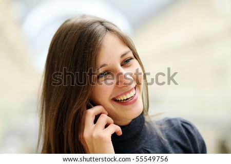 Closeup woman with mobile telephone