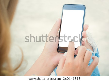 closeup women using phone from back view