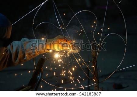 Closeup Worker welding sculpture art