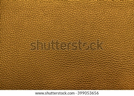Closeup yellow gold leather texture. leather background and leather surface for design. leather skin with copy space for text or image.