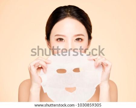 closeup young beauty face and facial mask
