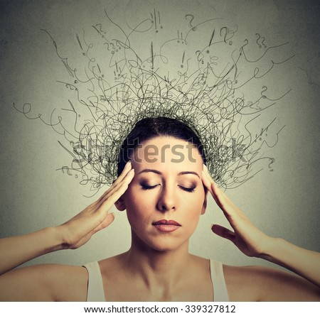 Closeup young woman with worried stressed face expression eyes closed trying to concentrate with brain melting into lines question marks deep thinking. Obsessive compulsive, adhd, anxiety disorders